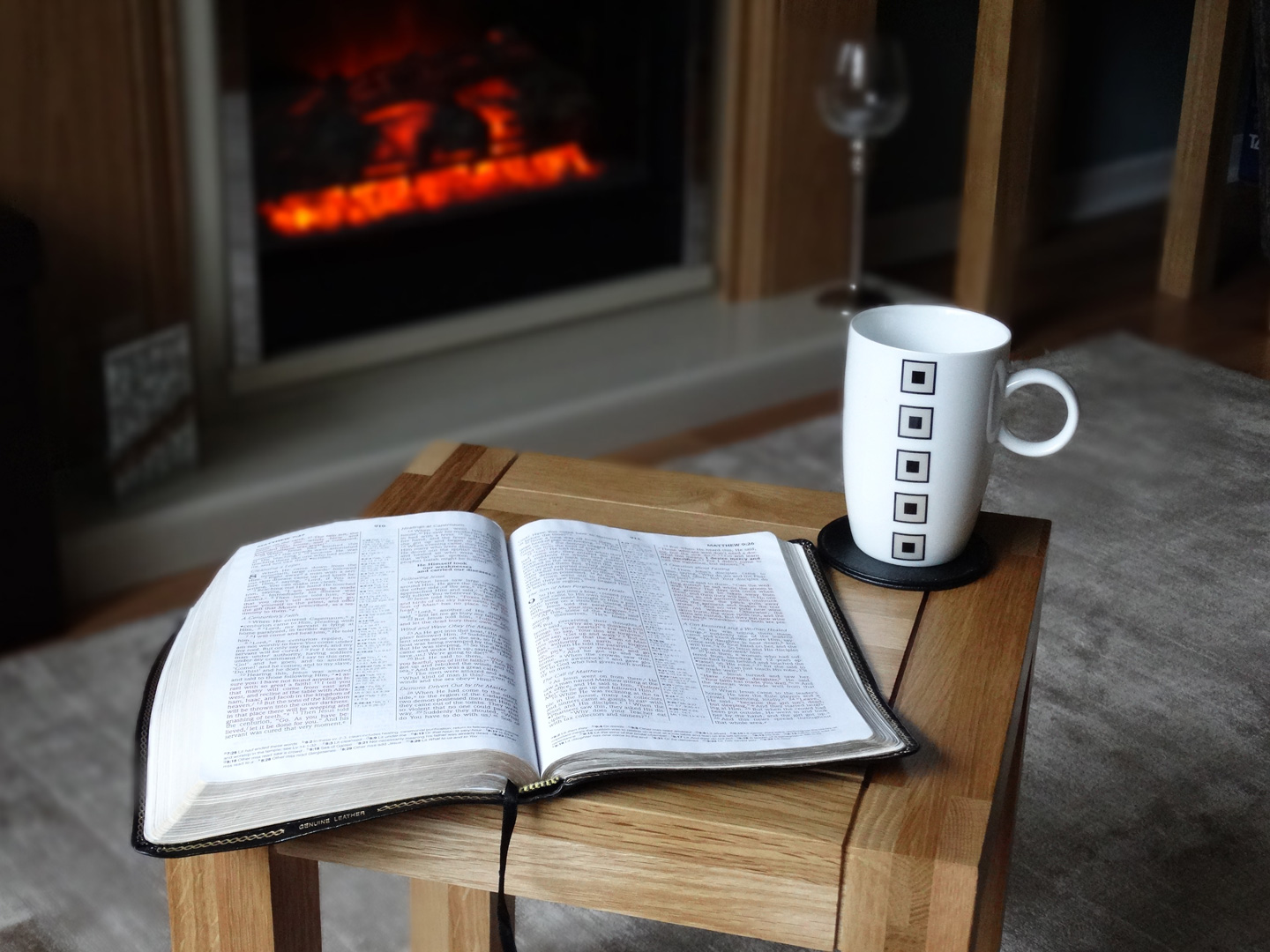 Open Bible, coffee, fireplace