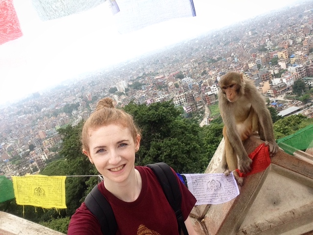 Emma and monkey overlooking Kathmandu