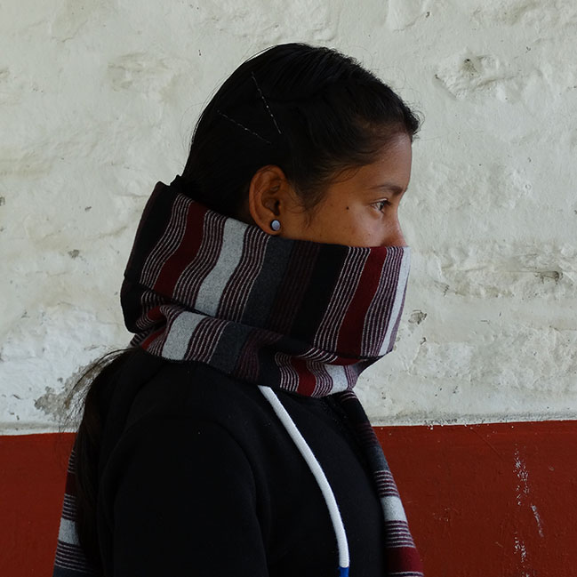 Girl with scarf covering face
